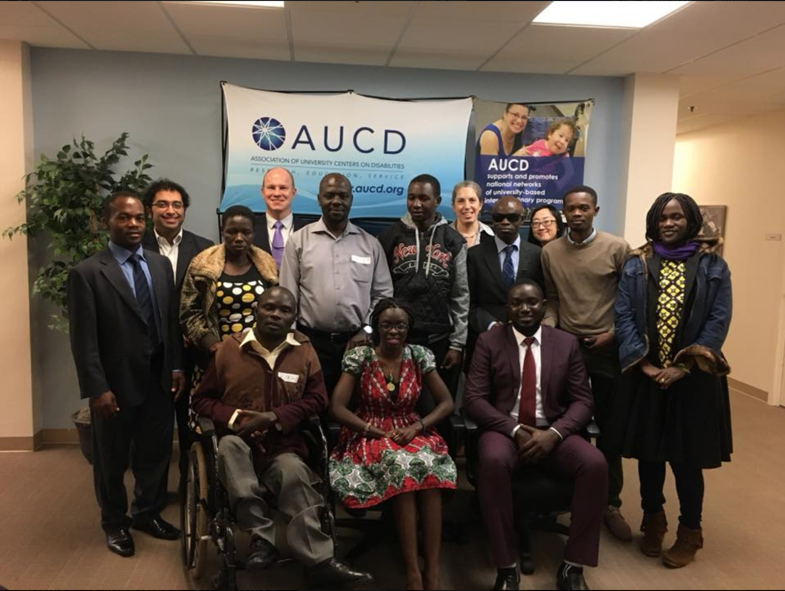 Photo of spring 2018 fellows in front of AUCD Logo